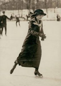 Young woman ice skater on park lake. Photograph by Carl Michel,  ca. 1915 Missouri History Museum Photograph and Print Collection. Carl Michel Collection  n36227